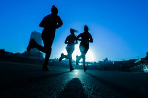 group of people running at night
