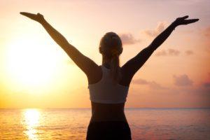 woman greeting the sun